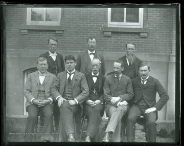 'Faculty, June 1897 Front row, left to right, James Stewart (Math); R.A. Armstrong (Eng); John I. Harvey (Mod. Lang); St. George Tucker Brooke (Law); Sam Brown (Geo); Back, left to right, P.B. Reynolds (Metaphysics); Thomas Hodges (Phys); R.W. Donthat (Ancient Lang).'