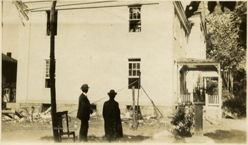 'Dr. A. W. Anthony and I reviewing ruins of fire of October 24, 1928.