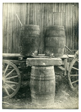 Barrels with spout on a cart.