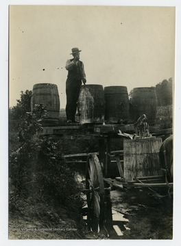 Mr. John Guseman stirring barrel contents.  For more details refer to A&M 55. official correspondence dated July 1, 1909.