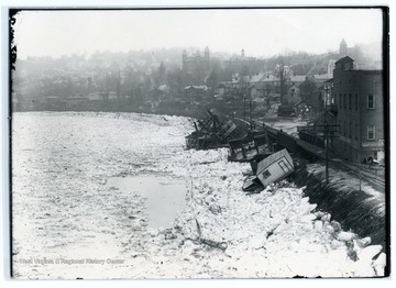 'Many boats docked along the Monongahela were crushed by heavy ice flows during the Winter of 1917 - 1918. This view shows the conditions that existed near the Walnut Street Wharf.'