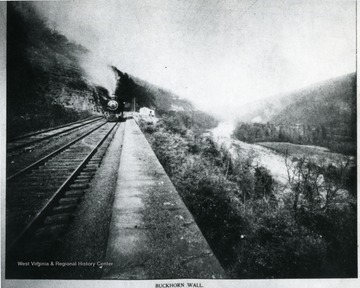 'This stupendous bit of masonry was one of the greatest achievements of early railroading.  It was built as a retaining wall for the bed of the Baltimore and Ohio Railroad, by Benjamin H. Latrobe, along the Cheat River, near Rowlesburg, W. Va., enabling the railway to cling safely to the side of the mountain.'