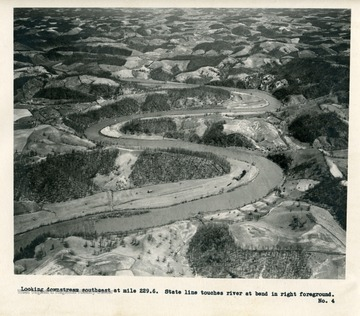 'Looking downstream southeast at mile 229.6.  State line touches river at bend in right foreground.'