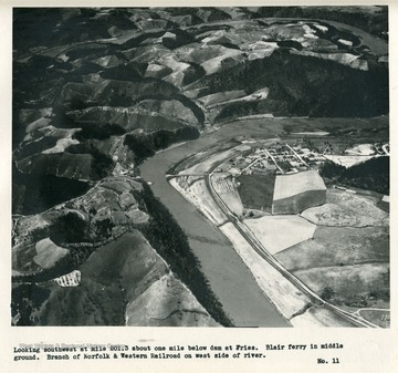 'Looking southwest at mile 201.3 about one mile below dam at Fries.  Blair ferry in middle ground.  Branch of Norfolk & Western Railroad on west side of river.'