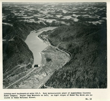 'Looking east southeast at mile 192.5.  Buck hydroelectric plant of Appalachian Electric Power Company; Poplar Camp Mountain on left; on right slopes of Round Top which are included in Unaka National Forest.'