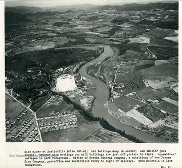 'Zinc mines at Austinville (mile 185.4); old tailings dump in center; old smelter just beyond; present main workings and mill buildings are just off picture to right.  Operatives' cottages in left foreground.  Office of Bertha Mineral Company, a subsidiary of New Jersey Zinc Company, post office and Austinville ferry to right of tailings.  Iron Mountain in left background.'