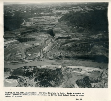 'Looking up Big Reed Island Creek.  Dry Pond Mountain to left; Macks Mountain to right.  Branch of Norfolk & Western extends up Little Reed Island Creek in right center of picture.'