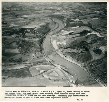 'Looking west at Allisonia, mile 170.2 about 4 p.m., April 27, after landing to refuel and change film.  Big Reed Island Creek entering under railroad bridge from left.  Excavations to left of river are old iron workings.  Recording gage installation of Geological Survey on bank of river near lower right-hand corner.'