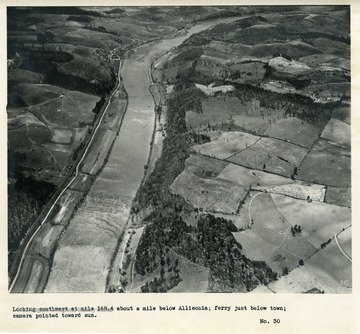 'Looking southwest at mile 168.4 about a mile below Allisonia; ferry just below town; camera pointed toward sun.'
