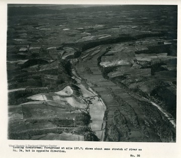 'Looking downstream; foreground at mile 157.7; shows about same stretch of river as No. 34, but in opposite direction.'