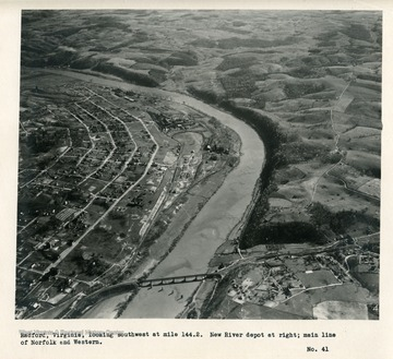 'Radford, Virginia, looking southwest at mile 144.2.  New River depot at right; main line of Norfolk and Western.'