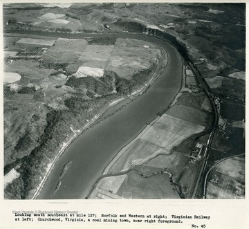 'Looking south at mile 127; Norfolk and Western at right; Virginian Railway at left; Churchwood, Virginia, a coal mining town, near right foreground.'