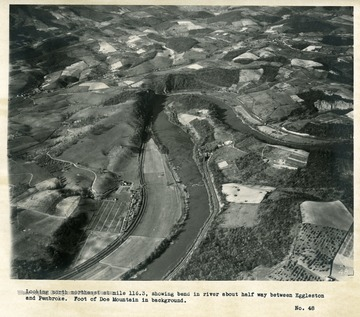 'Looking north northeast at mile 116.3 showing bend in river about half way between Eggleston and Pembroke.  Foot of Doe Mountain in background.'
