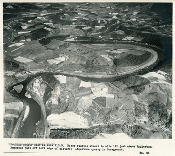 'Looking nearly east at mile 113.3  River visible almost to mile 121 just above Eggleston; Pembroke just off left edge of picture; limestone quarry in foreground.'