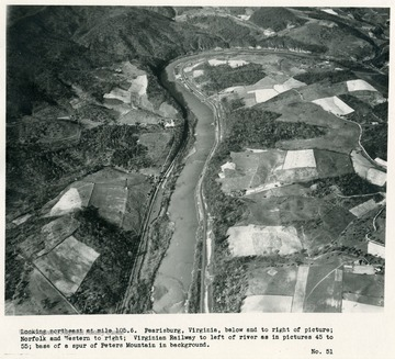 'Looking northeast at mile 105.6.  Pearisburg, Virginia, below and to right of picture; Norfolk and Western to right; Virginian Railway to left of river as in pictures 45 to 55; base of a spur of Peters Mountain in background.'