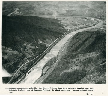 'Looking southeast at mile 99; the Narrows between East River Mountain (right)and Peters Mountain (left); town of Narrows, Virginia, in right background; camera pointed toward sun.'