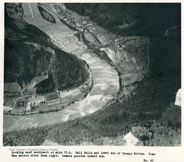 'Looking east southeast at mile 73.2.  Bull Falls and lower end of Crumps Bottom.  Toms Run enters river from right.  Camera pointed toward sun.'