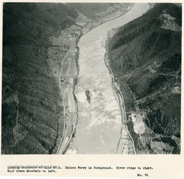 'Looking southeast at mile 67.5.  Haines Ferry in foreground.  River ridge to right.  Wolf Creek Mountain to left.'