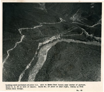 'Looking east northeast at mile 3.2.  Adit to Hawks Nest tunnel near center of picture.  Route U.S. 60 on side of canyon.  Route No. 19 joins it near right, coming up from Cotton Hill bridge.'