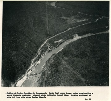 'Bridge at Gauley Junction in foreground.  Hawks Nest power house, under construction a short distance upstream; cleared strip indicates tunnel line.  Looking southeast at mile 1.0 (one mile above Gauley River).'