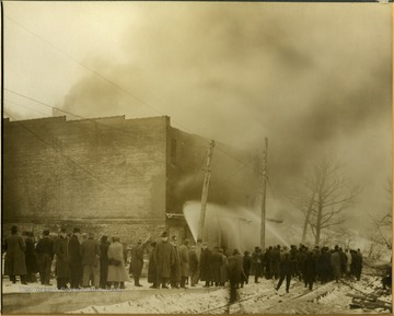 People watch as firemen try to put out the fire at S. C. Watkins Warehouse.