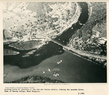 'Looking north at junction of the New and Gauley Rivers, forming the Kanawha River.  Town of Gauley Bridge, West Virginia.'