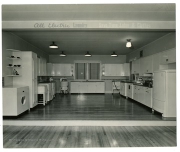 A display of modern kitchen with electric laundry machine.