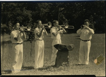 Boys with brass instruments - trombones and trumpet.