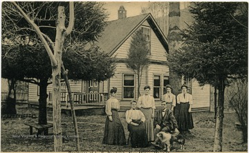 Picture shows Randolph and Wife with the 'Racket clerks.' Postcard sent to Mr. Geo. W. Albers, New Milton, W. Va. R. F. D. on June 19, 1913. Message: 'Your card to hand, Let the potatoes com first chance.'