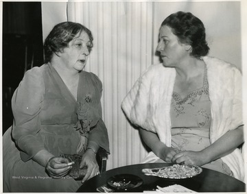 "'Nobel Prize Winners at Anniversary Dinner: Sigrid Undset(Left), Nobel Prize winner in Literature for 1928; and Pearl Buck, winner of 1938, meet for a chat before the Nobel Anniversary Dinner held Dec. 10 in New York City, held by the common council for American Unity.  The Anniversary Dinner in the U.S. this year was given in lieu of the annual awards made in Oslo and Stockholm, but which were interrupted by the war.  Pearl Buck said that unless a ""Miracle"" occurs another war might develop after the present struggle to save freedom for the world.  There were 26 other Nobel Prize winners at the dinner.'"
