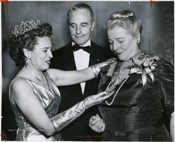 "'State Rep. Bessie A. Buchanan, of New York (left), and Mayor-elect Richardson Dilworth present the Philadelphia cotillion Society's Amethyst Cross of Malta to Pearl S. buck, noted author, for her ""unceasing activity in the cause of human rights"" at seventh Christmas cotillion at Convention Hall.'"