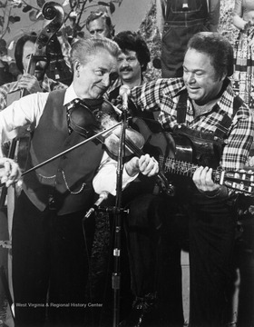 "Byrd plays a tune with Country singer Roy Clark on the popular TV show ""Hee Haw"".'Originals moved to R.C.B. Center for Legislative Studies, Shepherd University; digital.'"