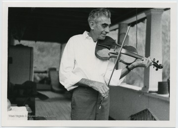 Melvin Wine playing the fiddle in Copen (Burnsville), Braxton Co., W.Va.