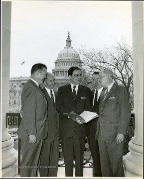 Underwood and group with capital in the background.