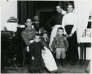 Patrick Gainer in the center wearing hat.