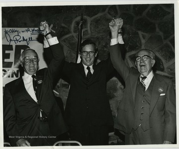 Jay Rockefeller, center, with Okey Patteson, right, at a Rockefeller re-election party.