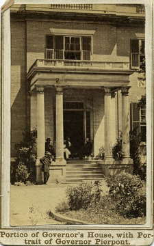'Portico of Executive Mansion. During the Rebellion this Mansion was occupied, in their respective terms by the Rebel Governors, Letcher and Smith, and is now the residence of Gov. Pierpont, who may be seen seated on the left of the portico, in company with Messrs. W.W. Weng, Treasurer of Virginia, W.D. Massey, P.M. of Alexandria, Va., and Colonel Hart of the Governor's Staff. Courtesy Mrs. J.C. Pryor'