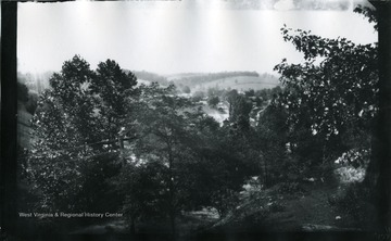 '197.W.83.B.; Looking West from hill side near where a spring is on the under side of rock. Used by village people so generally; August 11, 1884, Monday 3:40 pm'