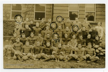 Group portrait of members of WVU Football team; those identified are 1) Phllips, Asst. Mgr.; 2) Hodges Q or HB; 3) Scott HB; 4)Smith E and 5) MacRae C.