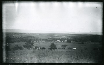 '(60)D. 97; July 30, 1884, Wednesday 11 a.m. clear; On extreme left is Mr. Stickley's farm in whose barn we spent the night. Strasburg lies a little too far to the left to come into sight. No 93 was taken from that stretch of pike a few roads from the house. When we came to the end of that straight portion we fastened the team and climbed that little rise which is crowned with a fringe of trees (it stands right over our head) and from that took No's 95 and 96. This view looks up the rather open valley of Cedar Creek, whose left on NE bank  was occupied by the Union army. The fighting was mainly at the extreme right of this view and along down the pike for several miles. The mts. in the distance mark the western part of the Shenandoah Valley.'