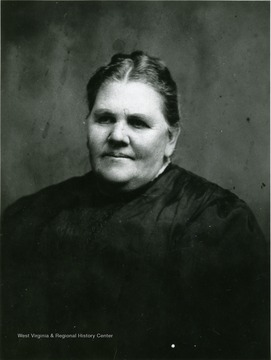 A portrait of Harriet Ellison, the daughter of Clara E. (Petrie) Dunlap and Addison Dunlap and the wife of J.Z. Ellison.