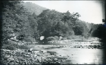 A photograph of a river with a horse and carriage on the left. '54 D(30); Thur. July 17, 1884 8 am'
