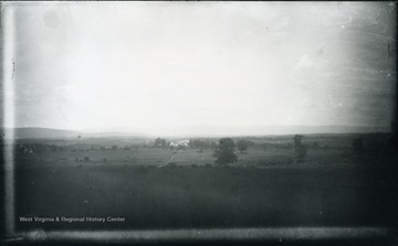 'Sheridan's headquarters, occupied in his absence by Gen. Emery and other officers in command. It is off to the West of the pike and in rear of formation of the 19th corps. The distant hill of No. 97 on the left. Our troops were driven across the field from the left towards the right; nearly parallel with the pike. 99.D.(61); July 30, 1884, Wednesday 12:15 clear'