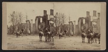 Stero card photograph of buildings in Chambersburg, Pennsylvania, burned by the Confederate Cavalry under General John Mc Causland of Mason County, West Virginia. Mc Causland's destructive raid was in reprisal for the burnings in the Shenandoah Valley by the Union troops.