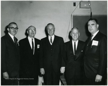 A portrait of Governor Hulett Smith (third from right) and West Virginia University president Paul Miller (second from right), standing with three other men.