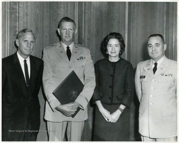 A portrait of Colonial Reynolds (first from right), Colonial Harvey Hartwig (second from right), Mrs. Hartwig (third from right) and President Miller (far left).