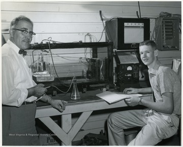 Helford Longhouse, one time Chairman of Agriculture Engineering Department, with a student in a laboratory.