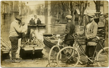 African-American boys with bicycles in foreground.