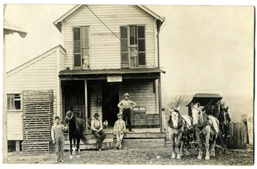 Some of his employees (or customers) are pictured along with his horse drawn delivery wagon.