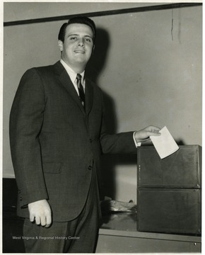 A photograph of James Kent casting his ballot in an election.